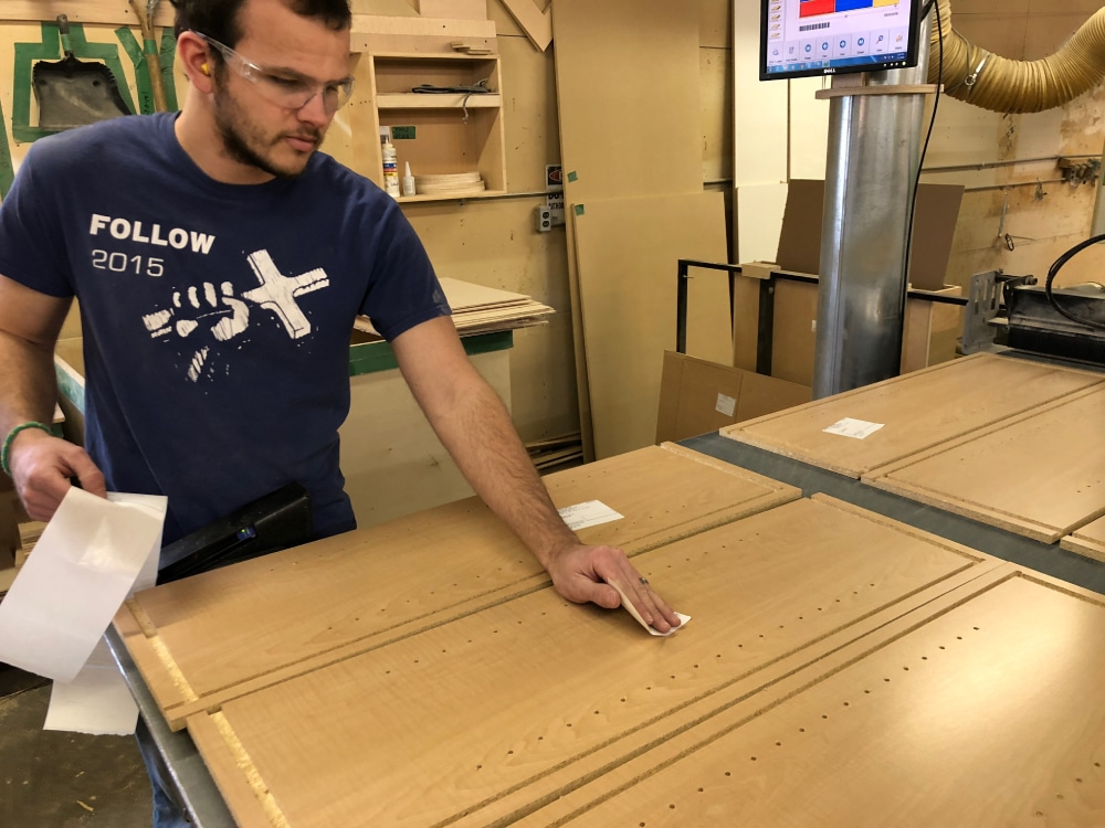 Devin applies the appropriate labels to cabinet sides