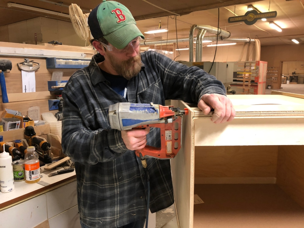 Tim puts the finishing touches on a cabinet