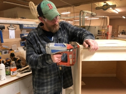 Tim assembles a cabinet